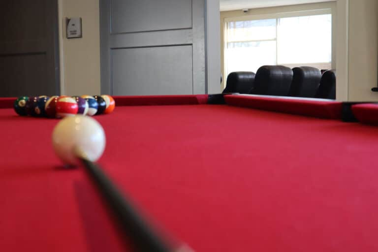 A billiards table set up at Hillside Commons